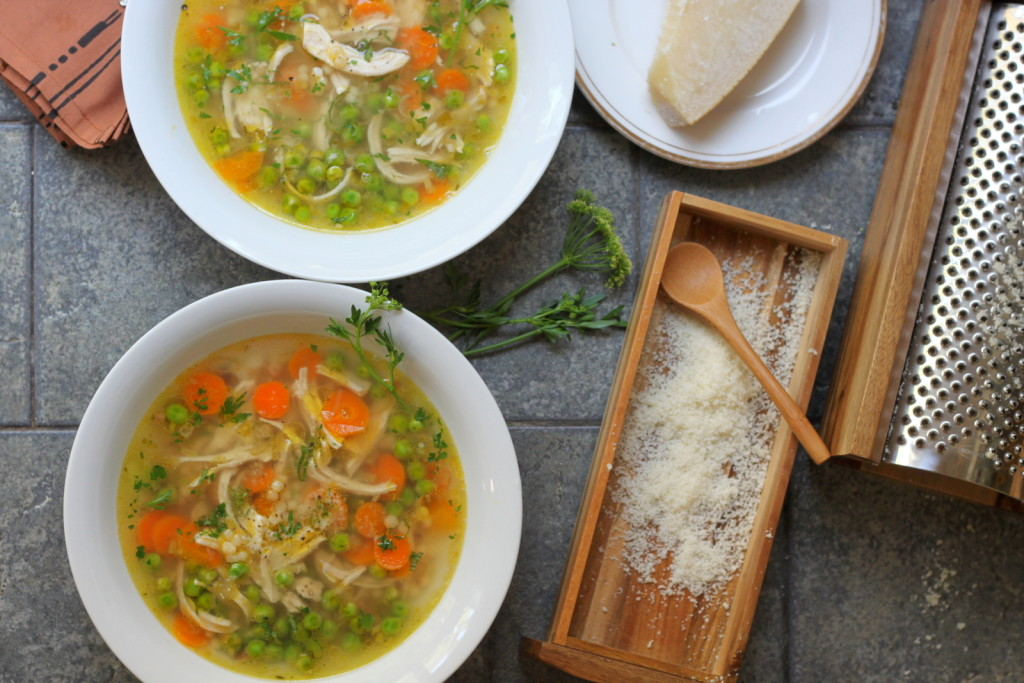A Bright and Delicious Spring Chicken Soup with Fresh Peas, Fregola, Parmesan and Mint